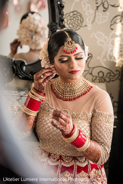 indian bride,indian wedding hair and makeup,bridal ceremony fashion