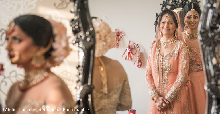 Lovely capture of Indian bridesmaids looking at bride.
