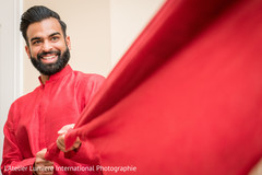 Indian groom getting ready for ceremony.