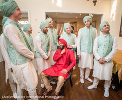 Fun capture of Indian groom with groomsmen getting ready.