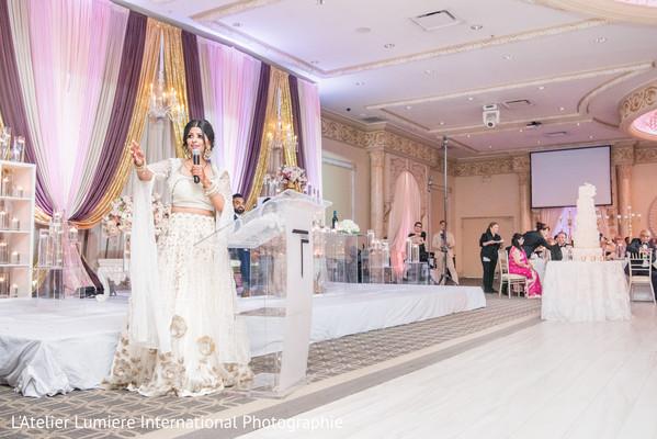 Indian bridesmaid capture during speech.