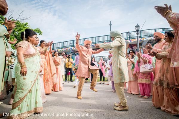 Indian groomsmen dance at the baraat celebration.