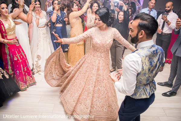 Sweet Indian couple having their reception dance.
