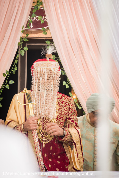 Indian groom with his Sehra covering his face.
