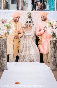 Joyful Indian bridal entrance to ceremony.
