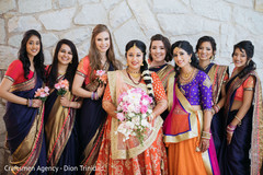 Beautiful bridesmaids posing with the Maharani prior to the ceremony