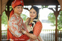 Beautiful shot of Indian couple looking at the camera