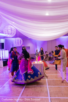 Beautiful capture of Indian newlyweds and guests dancing