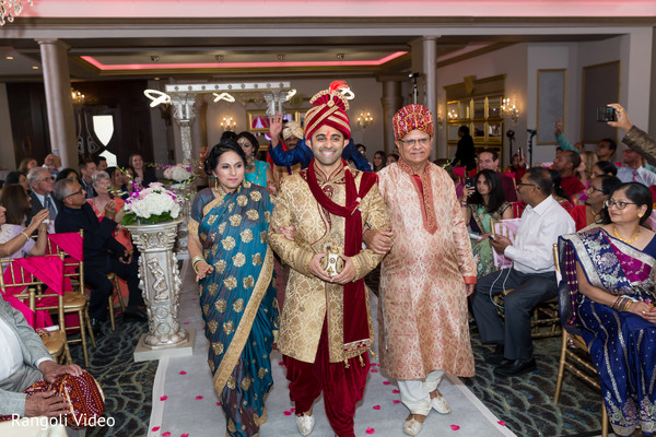 Indian groom escorted by his parents