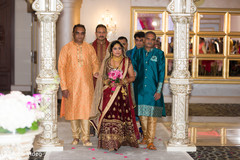 Indian bride escorted by her family making her entrance