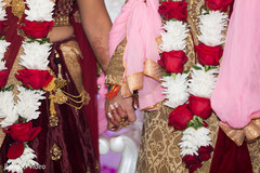Lovely shot of Indian bride and groom holding hands