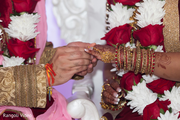 Indian bride receiving the ring during the ceremony