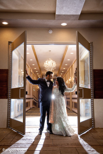 Indian groom and bride posing at the venue