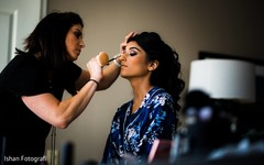 Gorgeous Maharani being assisted with her makeup