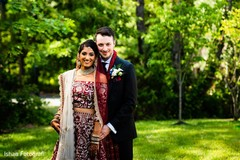 Indian lovebirds posing for pictures outside
