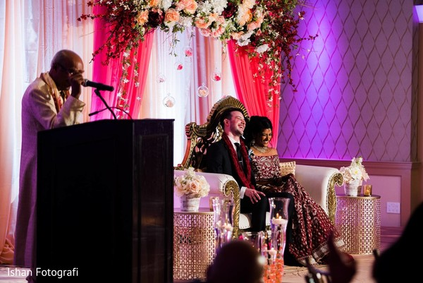 Lovely newlyweds laughing at the reception