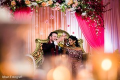 Indian bride and groom making a toast at the reception