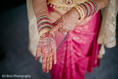 Indian bride showing her beautiful mehndi design