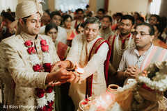 Indian groom during a moment of the rituals