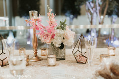 Floral arrangement details on the table at the reception