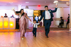 Special guests and kid entering the reception venue