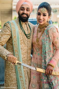 Ravishing Indian newlyweds posing with the kirpan