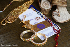 Great capture of bridal jewelry, shoes and invitations photo.