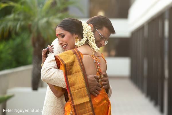 Indian relative hugging bride.