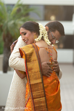 Heartwarming Indian bride and father capture.