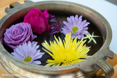 Colorful Indian wedding flowers on a pot decor.