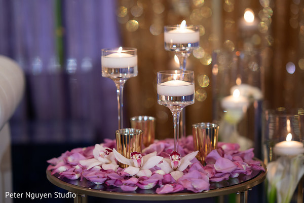 Incredible Indian wedding candle and petals decor.