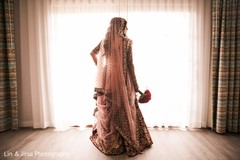Marble Indian bride's red and golden lengha.