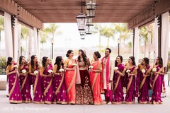 Sweet Indian bride, bridesmaids and groomsmen posing for photo.