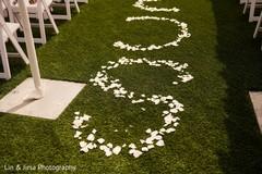 Lovely Indian wedding ceremony aisle flower decoration.