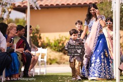 Lovely Indian guest boy announcing bride to come.