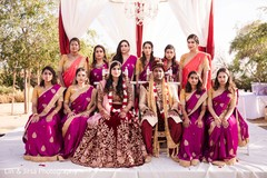 Indian wedding portrait with bride, groom, and  bridesmaids.