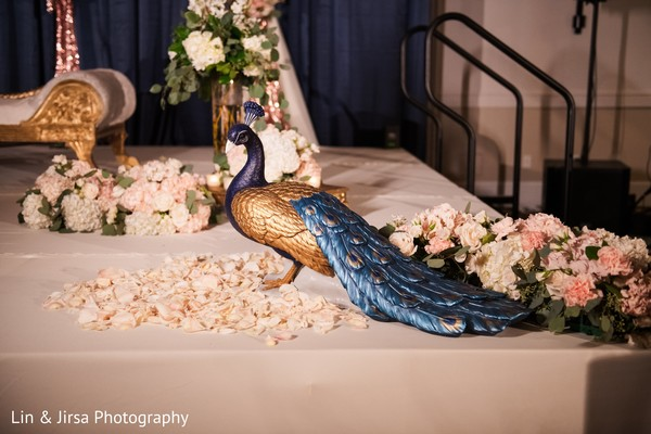 Incredible Indian wedding reception Peacock decoration.