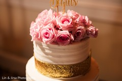Colorful roses on Indian wedding cake.