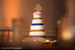 White, blue and golden Indian wedding cake.
