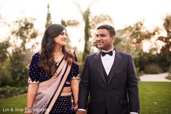Lovely Indian bride and groom posing for an outdoor photo.