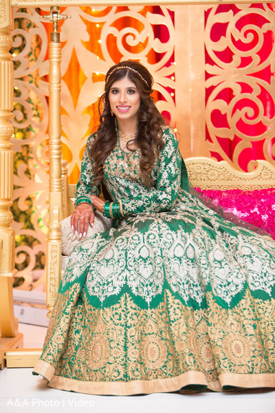 Indian bride posing for pictures wearing the lengha