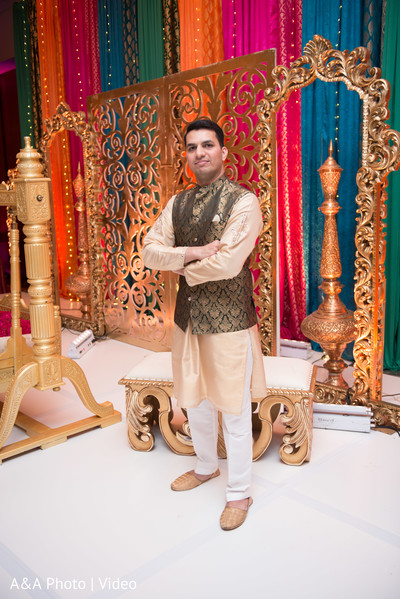 Indian groom at the venue posing for pictures