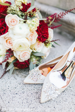 Incredible Indian bridal bouquet and stoned shoes capture.