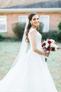 Glamorous Indian bride posing outdoors.