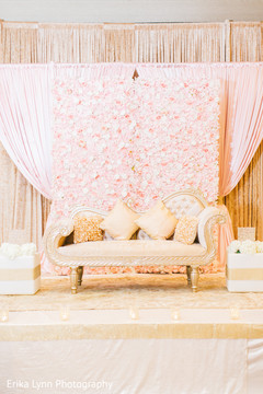 Stunning Indian wedding stage flower and sofa decoration.