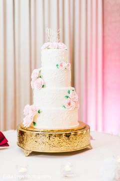 White and rose Indian wedding cake.