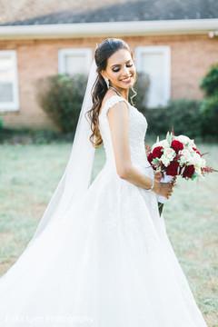 Glamorous Indian bride posing for photoshoot.