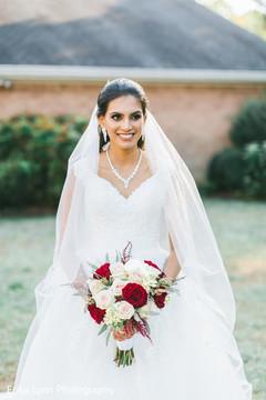 Ravishing Indian bride on her white dress.
