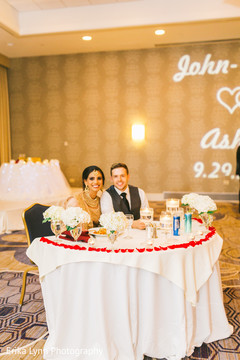 Lovely Indian couple at their reception table.