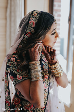 Indian bride getting ready with her jewelry